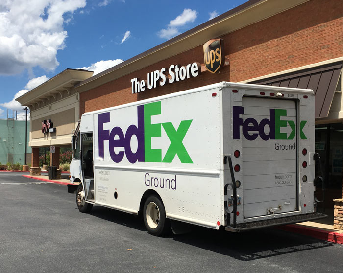 Fedex Truck parked at UPS Store